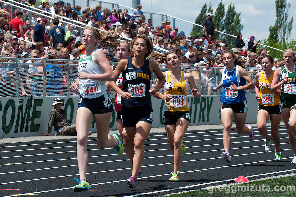 Mountain View junior Sam McKinnon, Meridian senior Lila Klopfenstein, Boise sophomore Emily Hamlin, and Vallivue sophomore Mikayla Malaspina lead the pack during the third lap of the Idaho High School State Track and Field Championships 5A 1600 meter run on May 18, 2013 at Eagle High School, Eagle, Idaho.<br /> <br /> McKinnon won the race (5:01.87) and was followed by Hamlin (5:02.91) and Klopfenstein (5:03.74), Borah freshman Sara Christianson (5:06.70), Timberline  senior Louisa Serpe (5:07.44) and Malaspina (5:08.69).