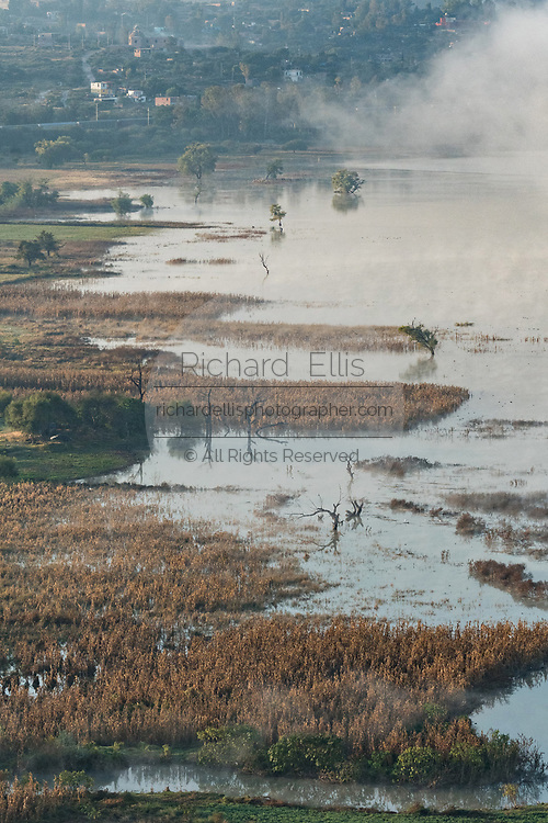 A flooded farm field consumed by Presa Isabel Allende lake outside the colonial city of San Miguel de Allende, Mexico.