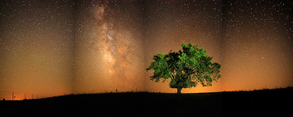 The Milky Way rises over the dark skies of the Flint Hills of Kansas.