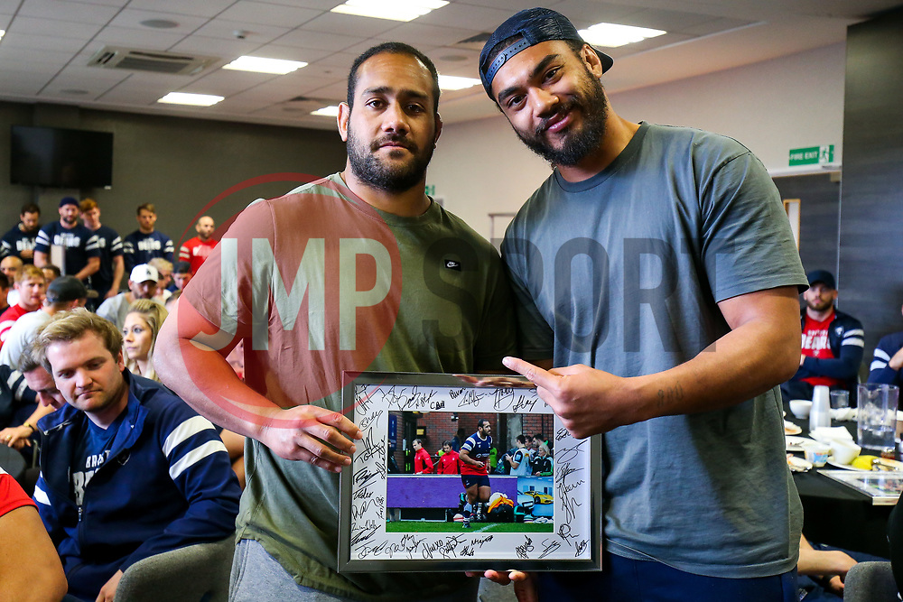 Chris Vui thanks Sione Faletau as the Bristol Bears squad gather to make presentations to departing players after the Bristol Bears Team Run ahead of the Sale Sharks Game - Rogan/JMP - 02/05/2019 - RUGBY UNION - Ashton Gate Stadium - Bristol, England - Bristol Bears v Sale Sharks - Gallagher Premiership Rugby.