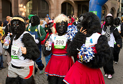 © Licensed to London News Pictures. 22/09/2012. LONDON, UK. Runners wearing gorilla costumes are seen at the start of the 2012 Great Gorilla Run in London today (22/09/12). Now in its 10th year, the annual event sees hundreds of competitors take part in a 7km fun-run dressed as gorillas to raise money for mountain gorilla conservation projects in Africa. Photo credit: Matt Cetti-Roberts/LNP