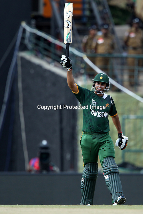 Nasir Jamshed celebrates his fifty during the ICC World Twenty20 Pool match between Pakistan and New Zealand held at the  Pallekele Stadium in Kandy, Sri Lanka on the 23rd September 2012<br /> <br /> Photo by Ron Gaunt/SPORTZPICS/PHOTOSPORT