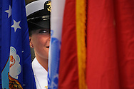 The Colors: Heather Hollis prepares to present the Air Force flag during a Memorial Day ceremony.