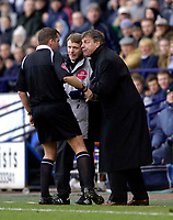 Photo: Jed Wee.<br /> Bolton Wanderers v Fulham. The Barclays Premiership. 26/02/2006.<br /> <br /> Bolton manager Sam Allardyce (R) is warned by referee Phil Dowd.