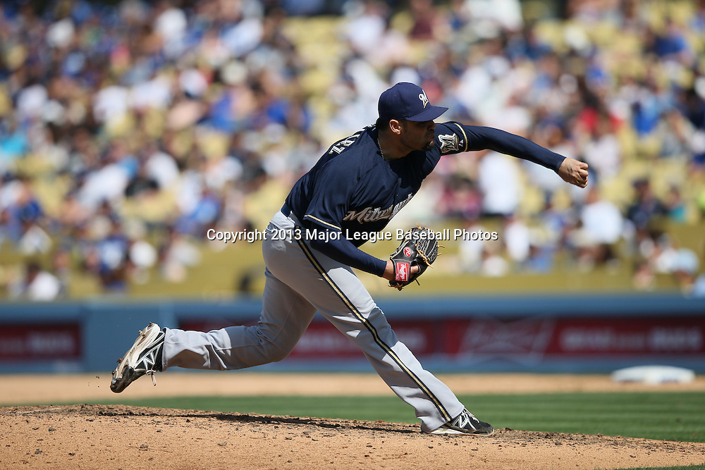 LOS ANGELES, CA - APRIL 28:  Mike Gonzalez #51 of the Milwaukee Brewers pitches during the game against the Los Angeles Dodgers on Sunday, April 28, 2013 at Dodger Stadium in Los Angeles, California. The Dodgers won the game 2-0. (Photo by Paul Spinelli/MLB Photos via Getty Images) *** Local Caption *** Mike Gonzalez