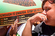 May 29 - PHOENIX, AZ: A woman at a pro-immigrants' rights rally in Phoenix, AZ, Saturday. More than 30,000 people, supporters of immigrants' rights and opposed to Arizona SB1070, marched through central Phoenix to the Arizona State Capitol Saturday. SB1070 makes it an Arizona state crime to be in the US illegally and requires that immigrants carry papers with them at all times and present to law enforcement when asked to. Critics of the law say it will lead to racial profiling, harassment of Hispanics and usurps the federal role in immigration enforcement. Supporters of the law say it merely brings Arizona law into line with existing federal laws.  Photo by Jack Kurtz