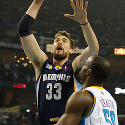 January 19, 2011; New Orleans, LA, USA; Memphis Grizzlies center Marc Gasol (33) shoots over New Orleans Hornets center Emeka Okafor (50) during the first quarter at the New Orleans Arena.   Mandatory Credit: Derick E. Hingle