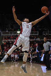 Stanford guard Dorian Pickens (11) grabs the ball against Colorado during the first half of an NCAA college basketball game in Stanford, Calif., Sunday, Jan. 3, 2016. Colorado won 56-55. (AP Photo/Jason O. Watson)