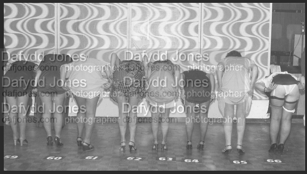 Contestants for the 'Loveley legs' competition at Butlins holiday camp.Minhead 1979.<br /> 12 x 16 inch silver gelatin print.. <br /> <br /> ONE TIME USE ONLY - DO NOT ARCHIVE  © Copyright Photograph by Dafydd Jones 66 Stockwell Park Rd. London SW9 0DA Tel 020 7733 0108 www.dafjones.com