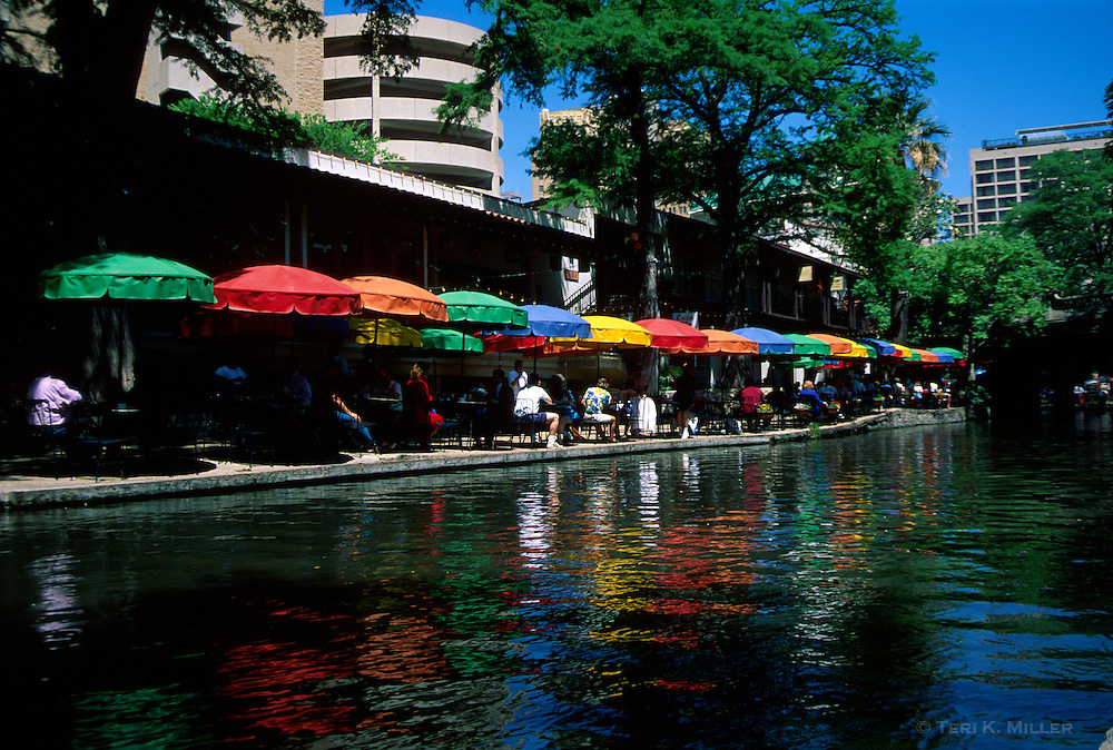 Restaurant with colorful umbrellas on the River Walk, San Antonio, Texas