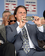 COOPERSTOWN, NY - JULY 27:  2014 Baseball Hall of Famer inductee Tony LaRussa takes a photo prior to the 2014 induction ceremonies held at the Clark Sports Center in Cooperstown, New York on July 27 2014.