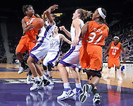 Oklahoma State guard Andrea Riley (L) drives to the basket against pressure from Kansas State's Shana Wheeler (C), as Kansas State's Kimberly Dietz and Oklahoma State's Danielle Green look on  during first half action at Bramlage Coliseum in Manhattan, Kansas, February 28, 2007.  Oklahoma State beat K-State 64-55.