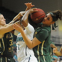 UNCW's Naqaiyyah Teague, center, battles for a loose ball with William and Mary's Brooke Stewart, left, and Kasey Curtis Sunday January 4, 2015 at Trask Coliseum on the campus of UNCW. (Jason A. Frizzelle)