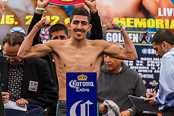 LOS ANGELES, CA - DEC 14: Unbeaten bantamweight titleholder Leo Santa Cruz (left) and Boxer Alberto Guevara (Right) at the Khan vs Molina official weigh-in at the Los Angeles Sports Arena in Los Angeles, CA 2012/12/14. Byline, credit, TV usage, web usage or linkback must read . Byline and/or web usage link must  read PHOTO: © Eduardo E. Silva/SILVEX.PHOTOSHELTER.COM.