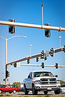 JEROME A. POLLOS/Press ..Vehicles pass under the traffic cameras Tuesday set above the intersection at Neider Avenue and U.S. 95