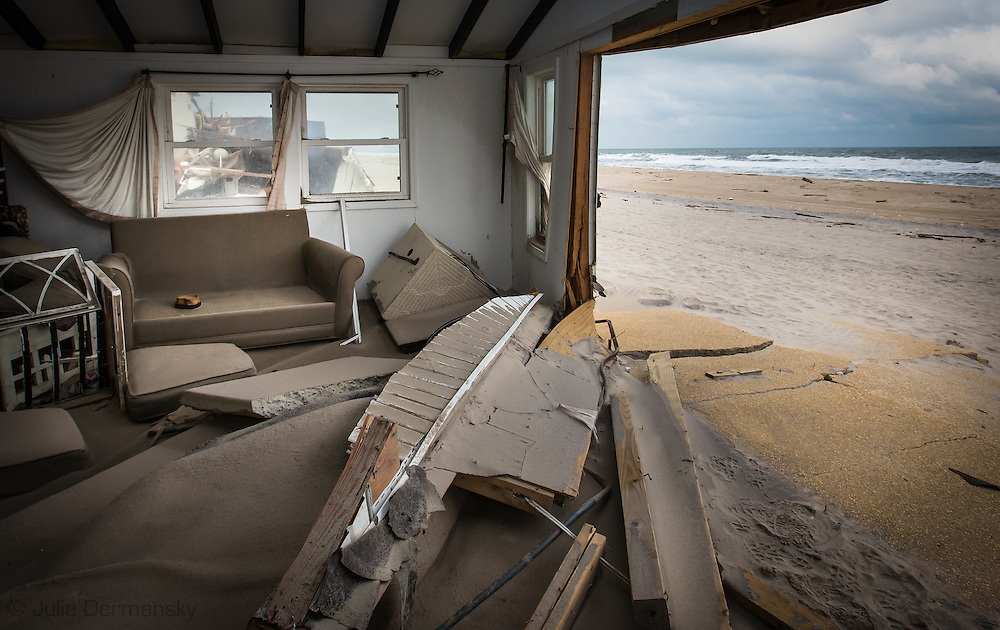 Beachfront home destroyed by Superstorm Sandy's surge in Ocean Beach, NJ. Hurricane Sandy hit the Jersey Shore as a tropical storm causing billions of dollars of damage and cutting electricity to hundreds of thousands. Extreme weather is being blamed on climate change by many scientist.