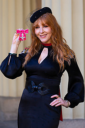 ROTA:  Charlotte Tilbury, makeup artist and founder Charlotte Tilbury Beauty proudly displays her MBE awarded for services to the beauty and cosmetics industry at an investiture at Buckingham Palace in London. London, November 13 2018.
