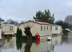 © Licensed to London News Pictures. 26/11/2012. Oxfordshire, UK Caravans sit in floodwater at the Bablockhythe Caravan and Holiday home park.  Flooding on the River Thames today 26th November 2012 in Oxfordshire. Photo credit : Stephen Simpson/LNP