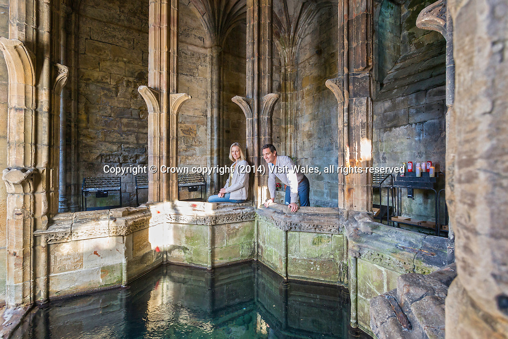 Couple visiting the Well<br /> St Winefride's Chapel and Well<br /> Cadw Sites<br /> SAMN: FL101<br /> NGR: SJ185762<br /> Holywell<br /> Treffynnon<br /> Flintshire<br /> North<br /> Holy Well<br /> Medieval / Tudor<br /> Religious, Ritual and Funerary<br /> Historic Sites<br /> Faith Tourism