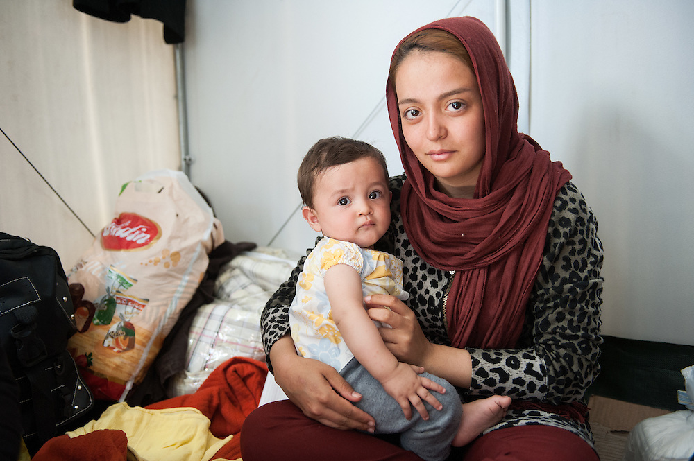 Zohre 19 years old old from Herat Afghanistan holding her 8 month old baby Mahdi in Moria camp, Lesvos, Greece
