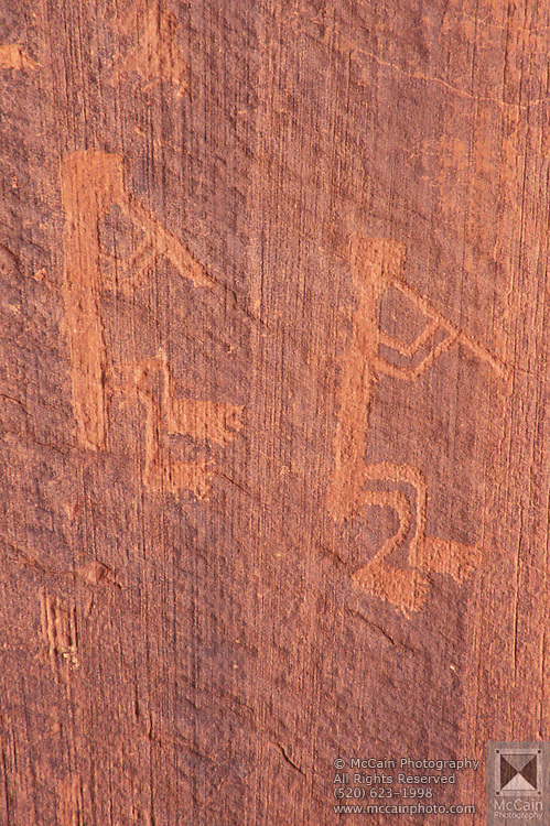 Anasazi petroglyphs of kokopeli, Monument Valley, Navajo Tribal Park, Arizona..Subject photograph(s) are copyright Edward McCain. All rights are reserved except those specifically granted by Edward McCain in writing prior to publication...McCain Photography.211 S 4th Avenue.Tucson, AZ 85701-2103.(520) 623-1998.mobile: (520) 990-0999.fax: (520) 623-1190.http://www.mccainphoto.com.edward@mccainphoto.com