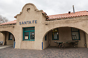 Sign on the wall of the old Santa Fe train station now the center of the Railyard District in Santa Fe, New Mexico.