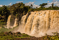 "The Blue Nile Falls is a waterfall on the Blue Nile river in Ethiopia. It is known as Tis Abay in Amharic, meaning ""great smoke"". It is situated on the upper course of the river, about 30 km downstream from the town of Bahir Dar and Lake Tana."