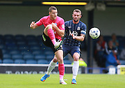 Peterborough United player Conor Washington lays off the bal under pressure from Southend player John White during the Sky Bet League 1 match between Southend United and Peterborough United at Roots Hall, Southend, England on 5 September 2015. Photo by Bennett Dean.