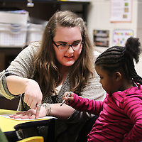 Adam Robison | BUY AT PHOTOS.DJOURNAL.COM<br /> Molly Beth Burks hleps Harmonee Tompkin with a coloring assignment in class at Parkway Elementary School in Tupelo.
