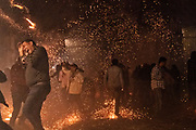 Dozens of sky rockets rain down on celebrants in the chaos of the Alborada festival in front of the Parroquia San Miguel Archangel church September 29, 2018 in San Miguel de Allende, Mexico. The unusual festival celebrates the cities patron saint with a two hour-long firework battle at 4am representing the struggle between Saint Michael and Lucifer.