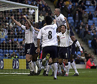 Photo. Glyn Thomas.<br /> Manchester City v Tottenham Hotspur. FA Cup fourth round. <br /> City of Manchester Stadium, Manchester. 25/01/2004.<br /> Spurs's Gary Doherty is mobbed by teammates after scoring his side's equaliser.