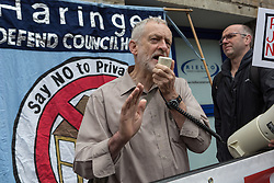 © Licensed to London News Pictures. 14/05/2016. LONDON, UK. JEREMY CORBYN joins demonstrators from a number of Islington housing groups at the start of a protest and march along Holloway Road, ending outside Holloway prison to protest against the housing bill and closure of Holloway prison. Protesters accuse the government of selling off the publicly owned inner city prison to private property developers, accelerating gentrification and worsening the UK's housing crisis. MP for Islington North, Jeremy Corbyn joined protesters and spoke of his support at the start of the demonstration.  Photo credit: Vickie Flores/LNP