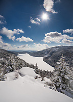 The view from North Bubble of Jordan Pond has to be one of the most beautiful in Acadia National Park. I captured it after the snow, as the came out and blue skies dominated the scene.