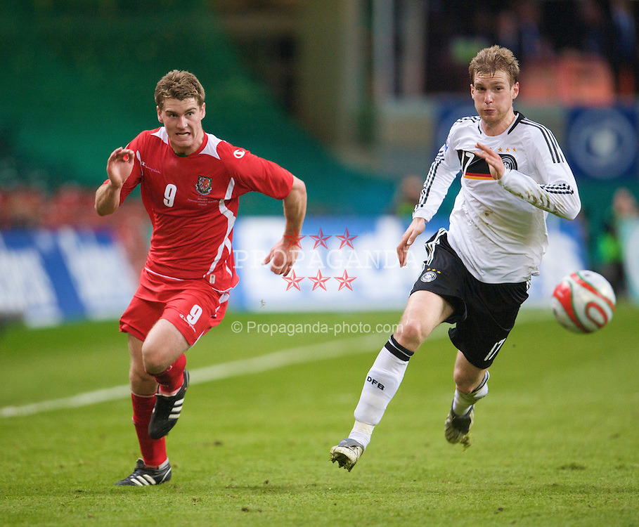 CARDIFF, WALES - Wednesday, April 1, 2009: Wales' Sam Vokes and Germany's Per Mertesacker during the 2010 FIFA World Cup Qualifying Group 4 match at the Millennium Stadium. (Pic by David Rawcliffe/Propaganda)