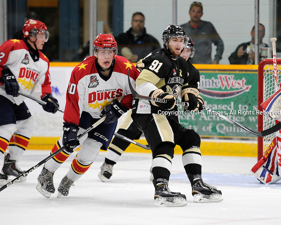 TRENTON, ON - Oct 3, 2014 : Ontario Junior Hockey League game action between Wellington and Trenton, Connor Judson #20 of the Wellington Dukes and Robert Smythe #91 of the Trenton Golden Hawks during the first period<br /> (Photo by Amy Deroche/ OJHL Images)