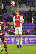 Ajax defender Rasmus Kristensen (2) goes up for a ball during a Florida Cup match against Flamengo at Orlando City Stadium on Jan. 10, 2019 in Orlando, Florida. <br /> <br /> ©2019 Scott A. Miller