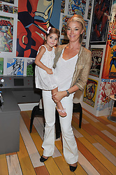 TAMARA BECKWITH and her daughter VIOLET VERONI at a party to celebrate the opening of Purple Dragon - A new family members club at Grosvenor Waterside, 30 Gatliff Road, London SW1 on 29th September 2011.
