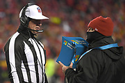 Jan 20, 2019; Kansas City, MO, USA; Referee Clete Blakeman reviews a play on the field during the AFC Championship game at Arrowhead Stadium. The Patriots defeated the Chiefs 37-31 in overtime to advance to their fifth Super Bowl in eight seasons. (Robin Alam/Image of Sport)