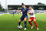 Jennifer Beattie (#5) of Scotland defends the ball against the challenge of Ramona Bachmann (#10) of Switzerland during the 2019 FIFA Women's World Cup UEFA Qualifier match between Scotland Women and Switzerland at the Simple Digital Arena, St Mirren, Scotland on 30 August 2018.
