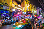 "18 JANUARY 2013 - BANGKOK, THAILAND:  The entrance to the Nana Entertainment Plaza on Sukhumvit Soi 4 in Bangkok. Prostitution in Thailand is illegal, although in practice it is tolerated and partly regulated. Prostitution is practiced openly throughout the country. The number of prostitutes is difficult to determine, estimates vary widely. Since the Vietnam War, Thailand has gained international notoriety among travelers from many countries as a sex tourism destination. One estimate published in 2003 placed the trade at US$ 4.3 billion per year or about three percent of the Thai economy. It has been suggested that at least 10% of tourist dollars may be spent on the sex trade. According to a 2001 report by the World Health Organisation: ""There are between 150,000 and 200,000 sex workers (in Thailand).""    PHOTO BY JACK KURTZ"