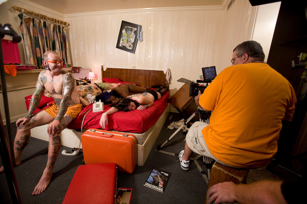 Scotty Body Wotty, host of the high definition HD travel series, Ink-Trotting, works on the show open with Scott Audette, director (in orange) in Austin, Texas. Photo by Scott Iskowitz/Scott Audette Inc.