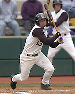 Kansas State's Brandon Farr hits a ground ball to the right side of the infield against Missouri in the bottom of the fourth inning at Tointon Stadium in Manhattan, Kansas.  Missouri defeated Kansas State 6-5, March 26, 2005.