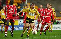 Indridi Sigurdsson, Lillestrøm. Seyi Olofinjana, Brann. Kenneth Storvik, Brann. Tippeligaen 2003: Lillestrøm - Brann 0-0. 25. mai 2003. (Foto: Peter Tubaas/Digitalsport)