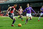 Brentford Forward Ollie Watkins (11) passes to Brentford Forward Sergi Canos (47) during the EFL Sky Bet Championship match between Brentford and Bolton Wanderers at Griffin Park, London, England on 13 January 2018. Photo by Andy Walter.