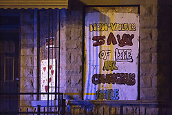 June 22, 2017 - Chicago, IL, USA - A sign hangs over a boarded-up window near the scene where two men, 35 and 23, were shot in the 1600 block of South Hamlin Avenue Thursday, June 22, 2017, in the Lawndale neighborhood of Chicago. The 23-year-old was shot once in the arm and twice in the abdomen and was taking to Mount Sinai Hospital in critical condition. (Credit Image: © Erin Hooley/TNS via ZUMA Wire)