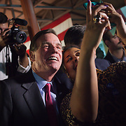 Virginia Senator Mark Warner takes a selfie with a supporter following a Democrat get out the vote (GOTV) rally at Market Square in Old Town Alexandria, VA, on  Monday, November 3, 2014, the day before Election Day.  Beyer is a candidate for the 8th District Congressional seat in Virginia speaks with a supporter.  John Boal Photography
