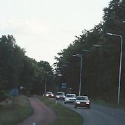 Politie helicopter keert terug naar Schiphol na zoekactie 2 vermiste Amerikaanse toeristen heide Crailoseweg Huizen