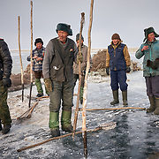 "Buryati ice fishermen try to catch fish on the ice for food at Russia's Lake Baikal. <br /> <br /> After decades of overfishing by the fishing industry, Baikal is running out of fish, and locals are bearing the consequence. <br /> <br /> Crowned the ""Jewel of Siberia"", Baikal is the world's deepest lake, and the biggest lake by volume, holding 20% of the world's fresh water. In the winter, the lake 31,722 square meter surface is entirely frozen with ice averaging 2 meters thick. Its ecology is one of the world's most critical."