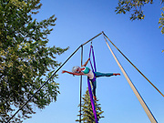 Mindy Cochran of Levitation Dance Nation, an aerialist, performing with silks at Thursday Fest in Kalispell, Montana.