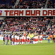 Players line up before kick off as New York Red Bulls fans display a banner during the New York Red Bulls V Sporting Kansas City, Major League Soccer Play Off Match at Red Bull Arena, Harrison, New Jersey. USA. 30th October 2014. Photo Tim Clayton